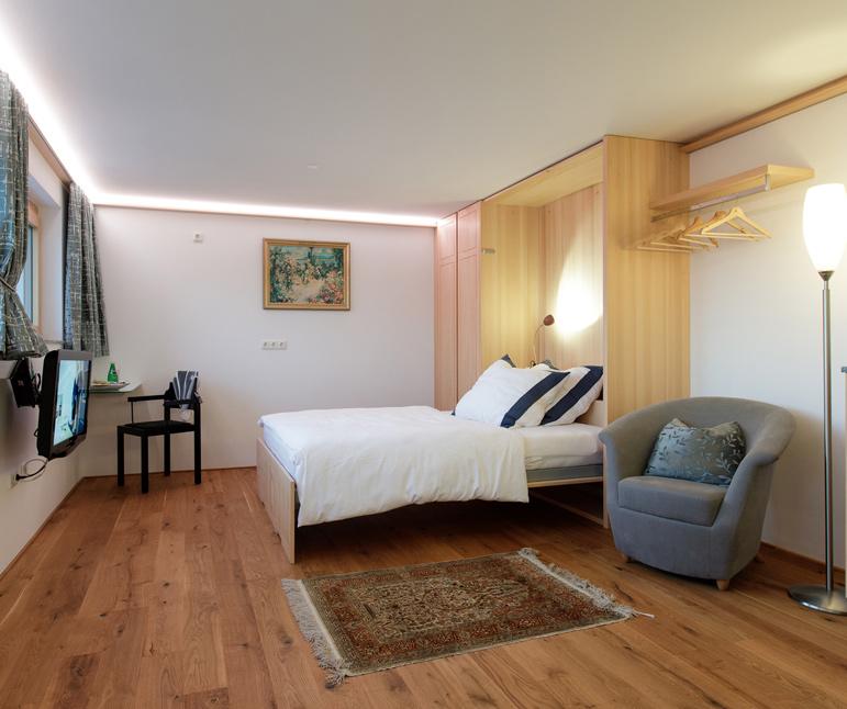 website-moosbrugger-zimmer-schlafbereich-wohnzimmer